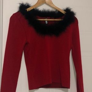 Red sweater with feather collar